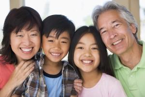 Grandparents posing with grandchildren