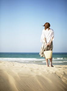 Woman on Beach Looking at Ocean
