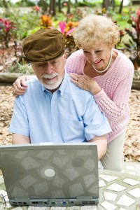 Senior Couple on Computer - Vertical